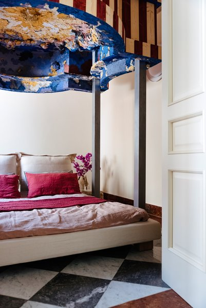 The four-poster bed was also customized by Piermattei.