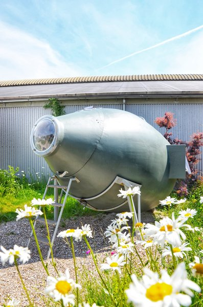 This sleeping pod, called Val Ross (Swedish for walrus), used to be a silo for animal food. Boris Duijneveld turned the barrel-like object on its side, put it on legs, and sawed off the tip, so guests can open it and crawl inside the rocket-like capsule.