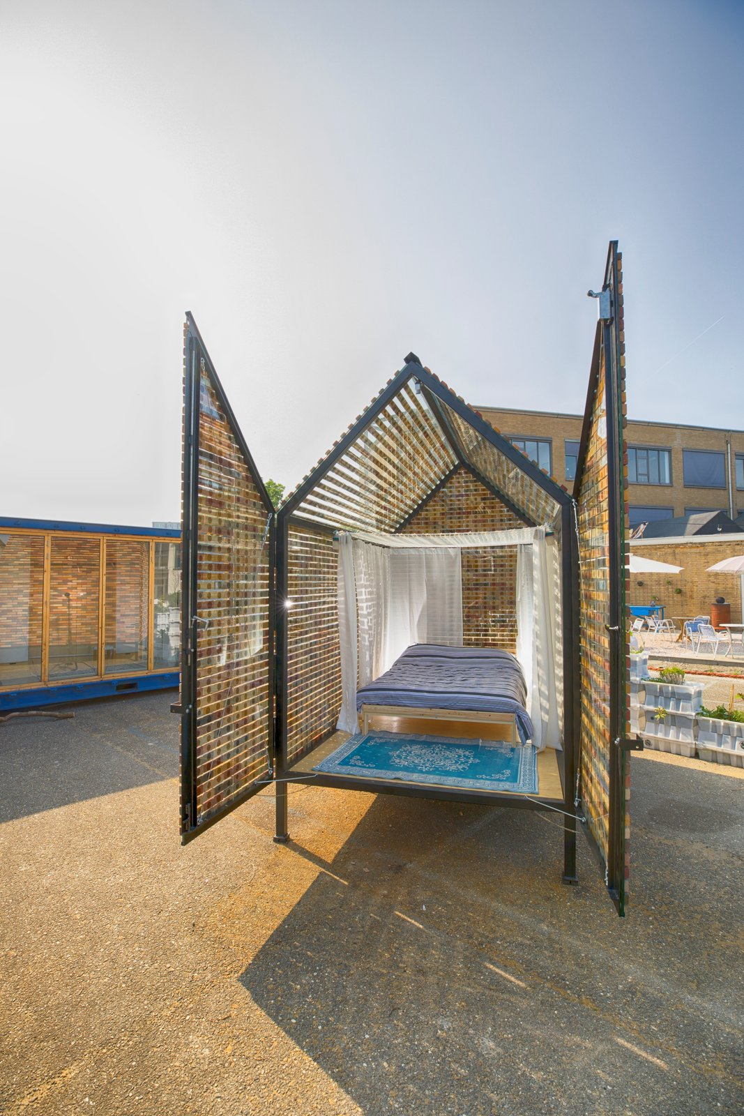 Exterior, Cabin Building Type, and Tiny Home Building Type Tiny house 'Floating Bricks' sleeps four people: a comfy hammock can be hung above the double bed.  Photo 10 of 15 in At This Quirky Campsite in Rotterdam, You'll Sleep in Upcycled Grain Silos and Calf Igloos from Culture Campsite Rotterdam