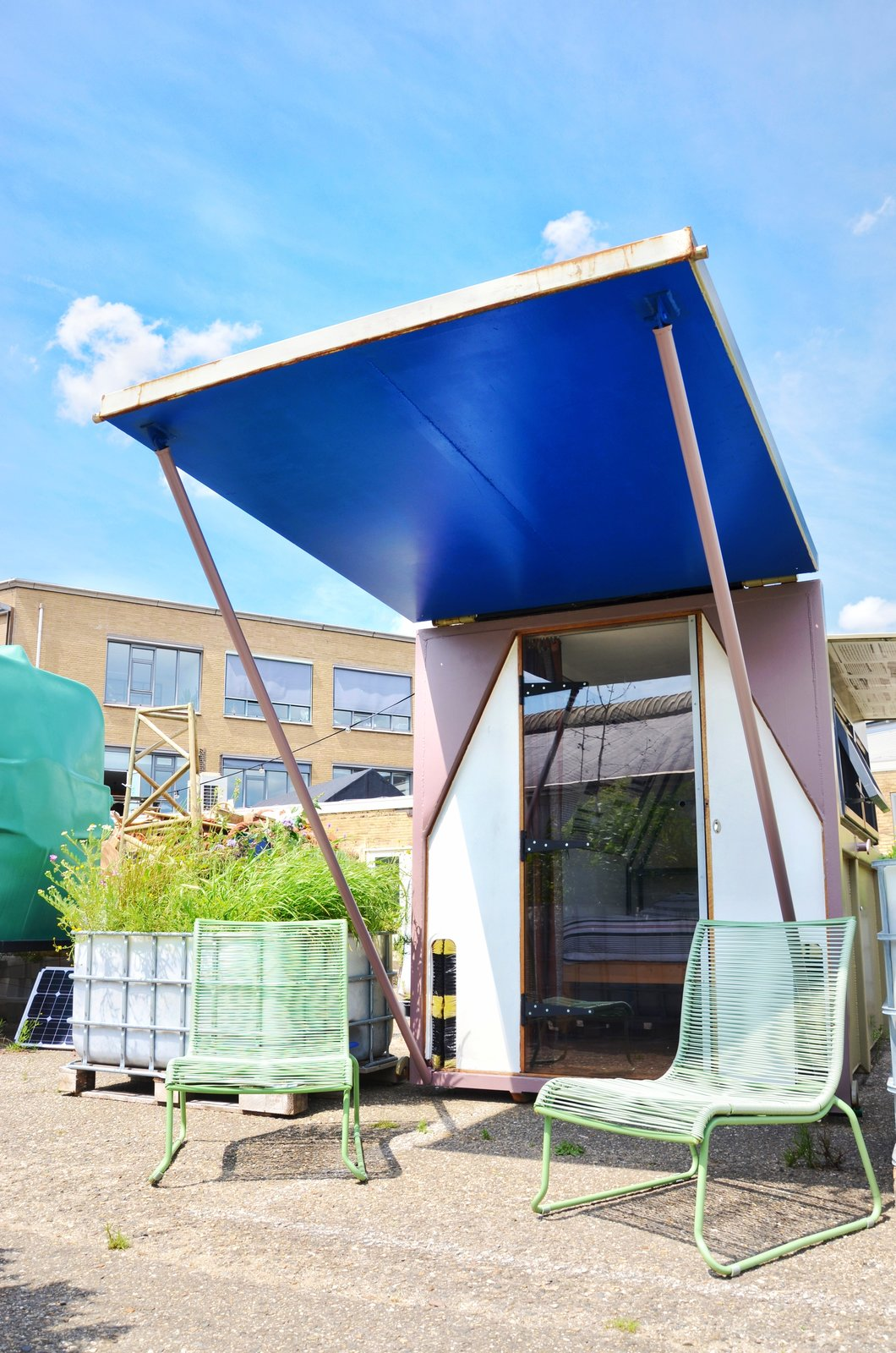 Exterior, Cabin Building Type, and Tiny Home Building Type 'Trash Inn' is a former garbage container.  Photo 14 of 15 in At This Quirky Campsite in Rotterdam, You'll Sleep in Upcycled Grain Silos and Calf Igloos from Culture Campsite Rotterdam