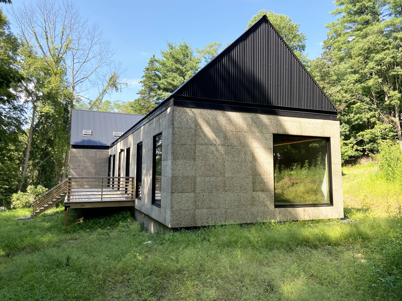 Exterior, House Building Type, Metal Roof Material, Metal Siding Material, Gable RoofLine, and Wood Siding Material Front exterior corner  Cork Haven by Multitude Studio