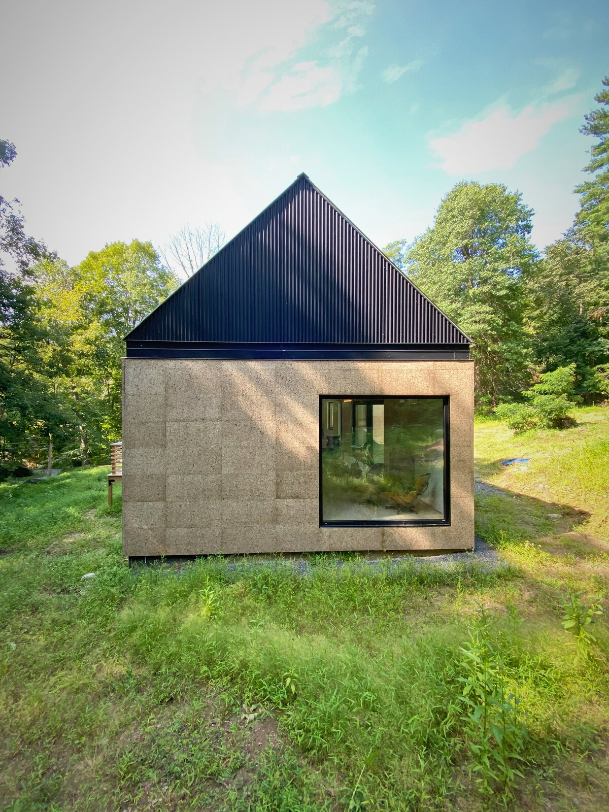 Exterior, Wood Siding Material, House Building Type, Gable RoofLine, Metal Roof Material, and Metal Siding Material Gable End   Cork Haven by Multitude Studio