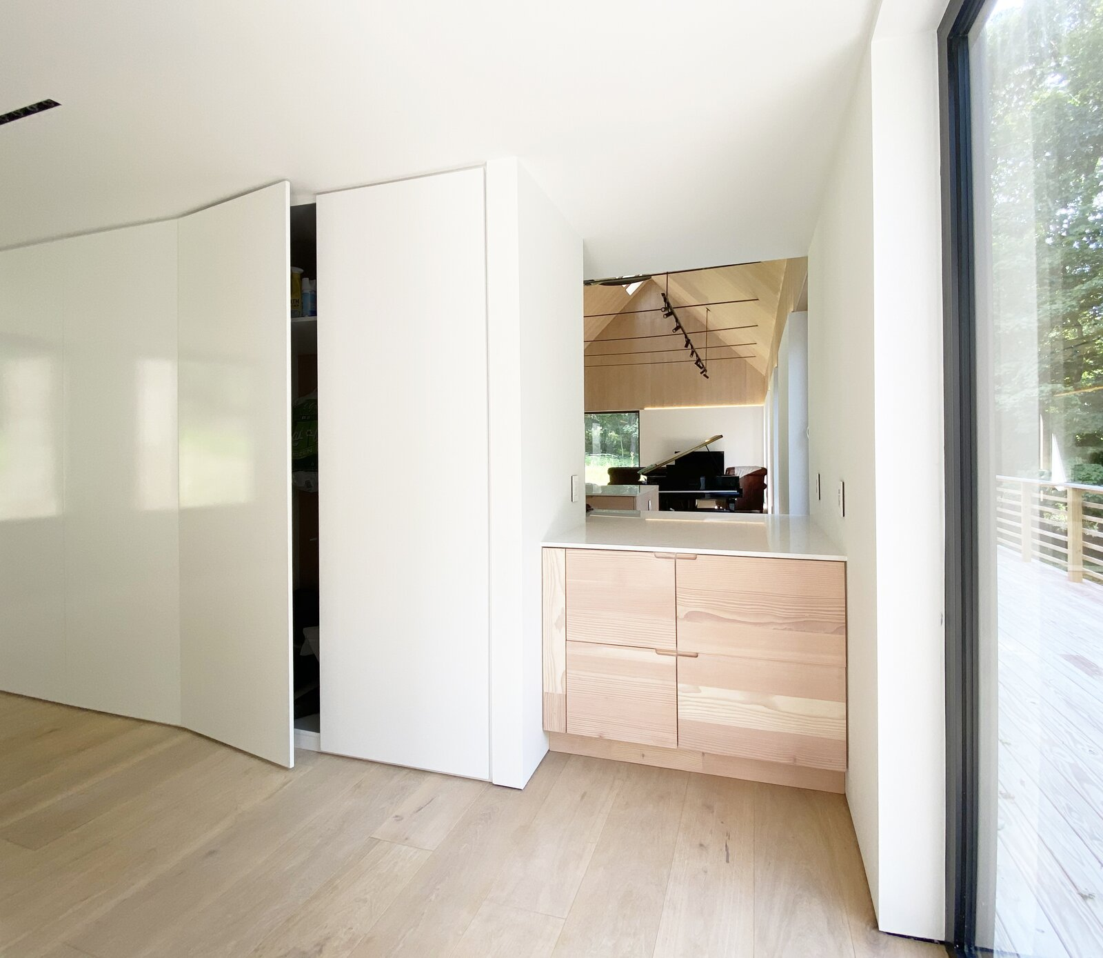 Storage Room, Closet Storage Type, and Cabinet Storage Type View upon entry  Cork Haven by Multitude Studio