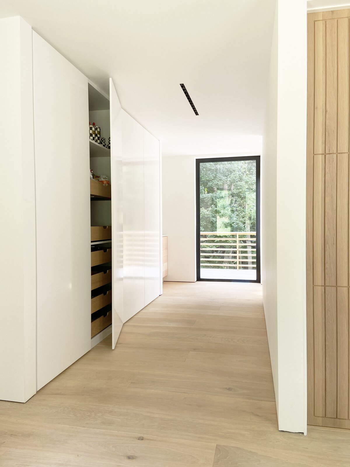 Storage Room, Cabinet Storage Type, and Closet Storage Type Built-in pantry hidden in a corridor  Cork Haven by Multitude Studio
