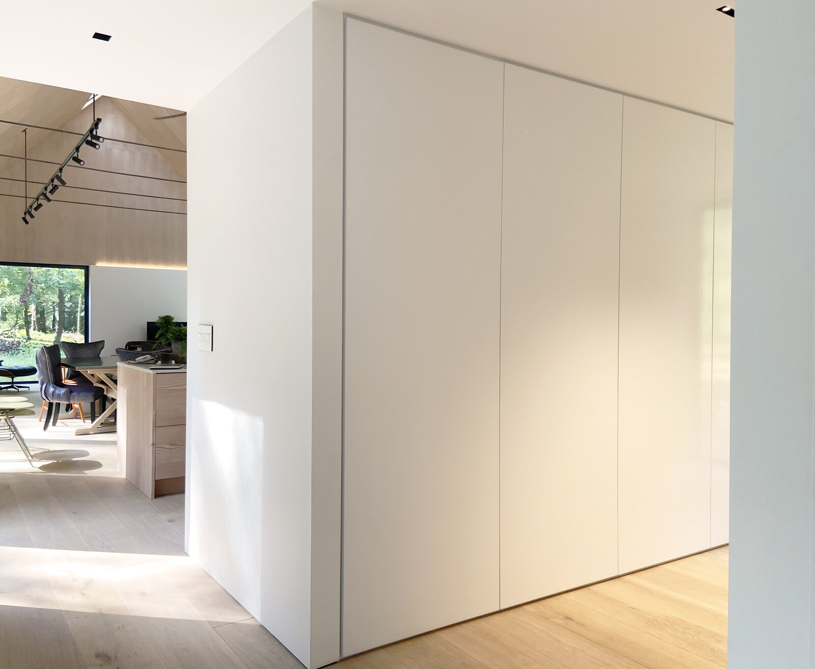 Storage Room, Cabinet Storage Type, and Closet Storage Type Pantry & Great Room entry  Cork Haven by Multitude Studio