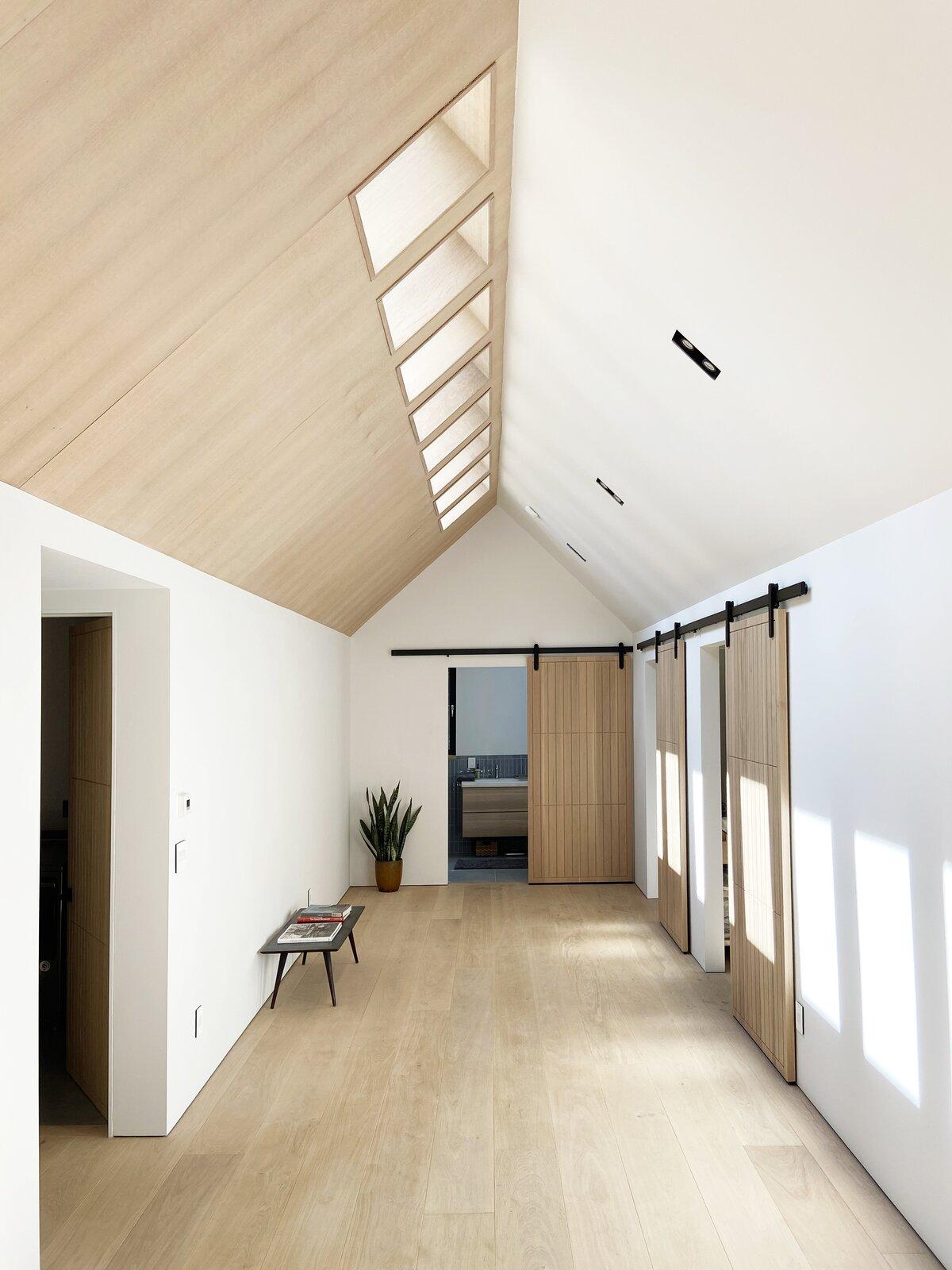 Hallway, Light Hardwood Floor, and Plywood Floor Bedroom Hallway  Cork Haven by Multitude Studio