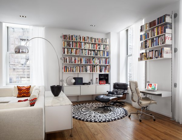 """Having spent more time at home in recent months, Nina and her family are truly experiencing the """"essence"""" of her design, she says. Their library corner, a space that was once underused, has become a place of respite for the family where they can gather on the Nanimarquina Rangoli rug and listen to records."""