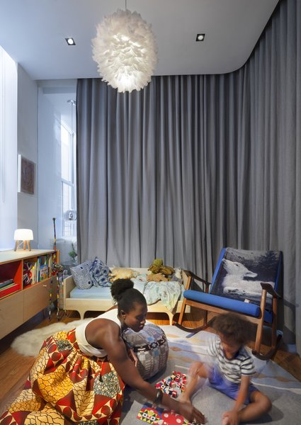 The Tribeca Loft responds to the evolving dynamics of Nina's family. Here, she and and her son spend time together in the office-turned-playroom.