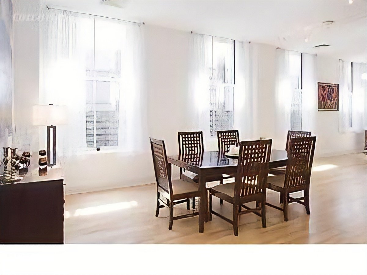 Before: The dining area received less light due to the original walls that blocked the windows in the back of the loft.  Photo 11 of 21 in Before & After: A Light-Catching Glass Box Brightens Up a Tribeca Loft