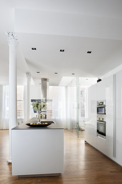 The exposed Corinthian columns beautifully accent the white Valcucine kitchen.