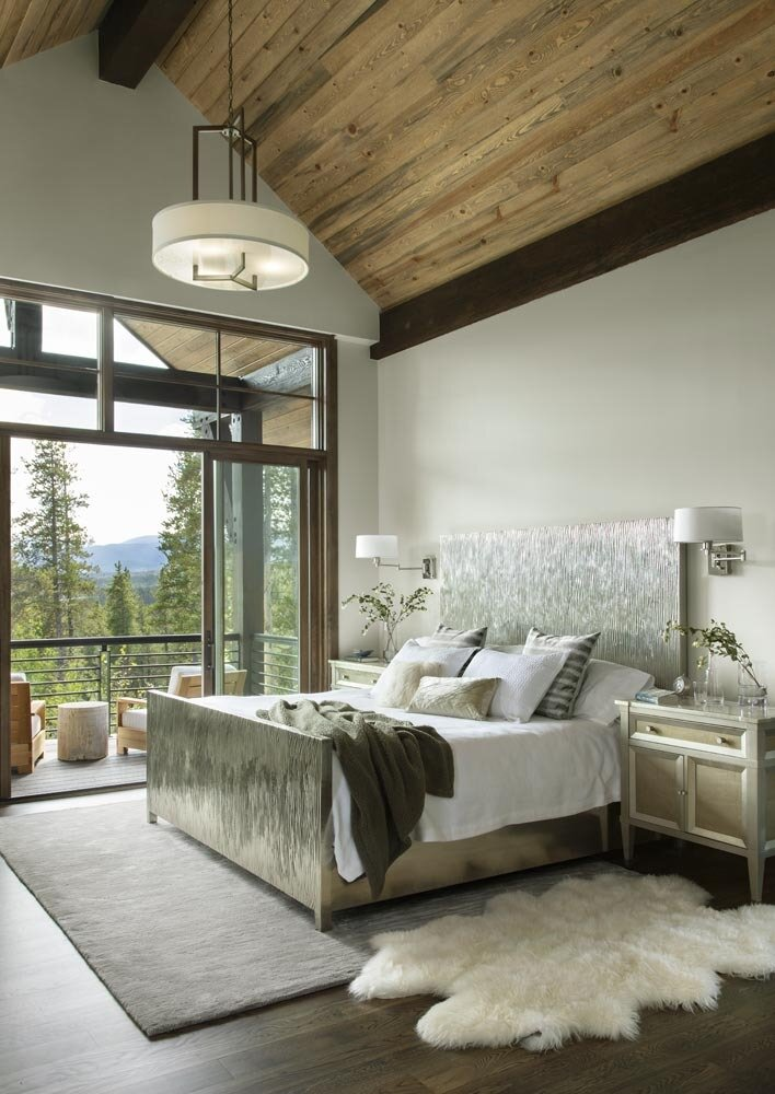Bedroom, Storage, Bed, Accent Lighting, Night Stands, Pendant Lighting, Ceiling Lighting, Wall Lighting, and Dark Hardwood Floor The glam German silver-leafed bed is flanked by matching side tables in the master bedroom.  Fairways at Pole Creek