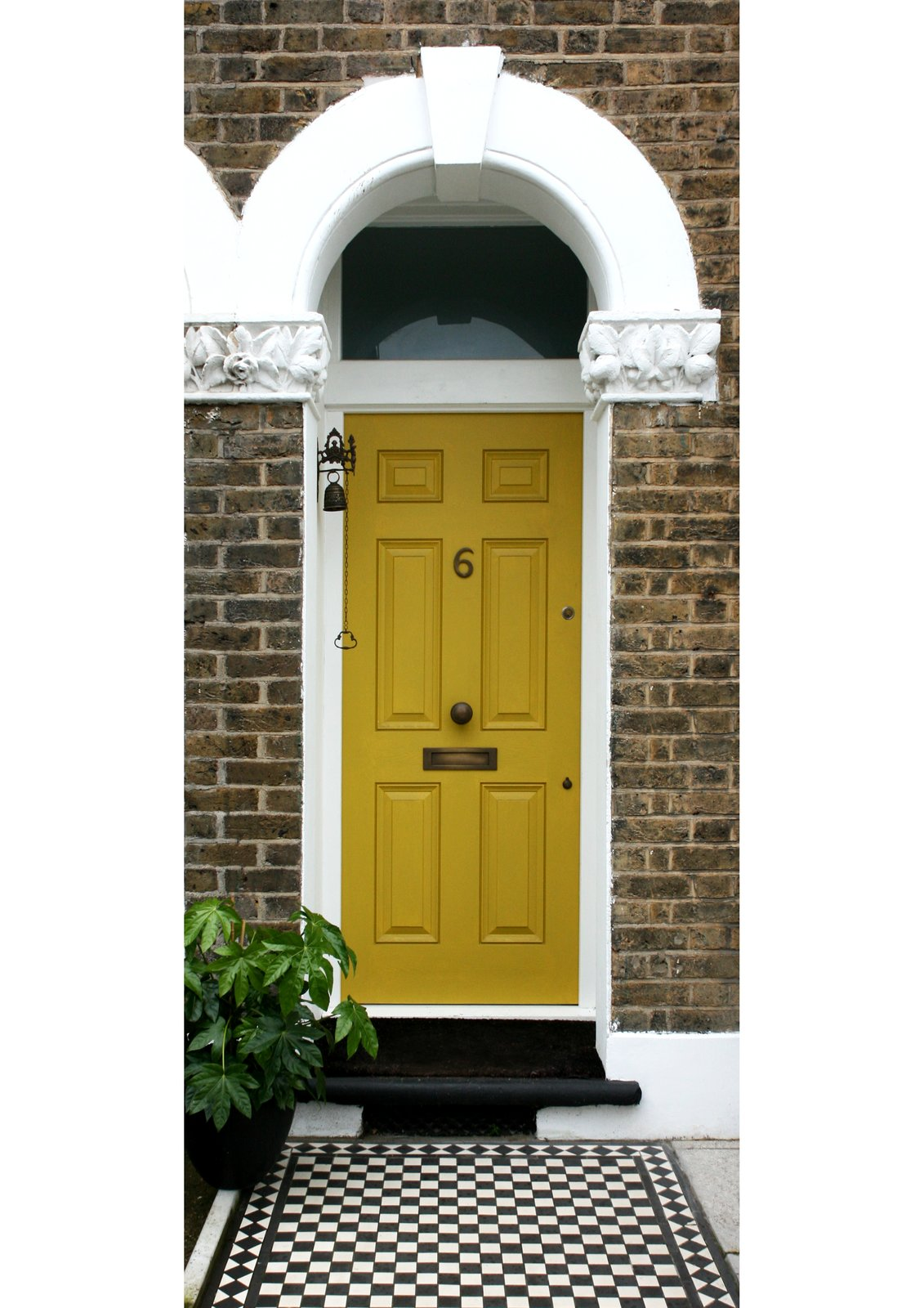 Exterior, Brick Siding Material, House Building Type, Tile Roof Material, and Flat RoofLine Entrance door with feature Victorian tiles  The Yellow Door by Tactus Design Workshop