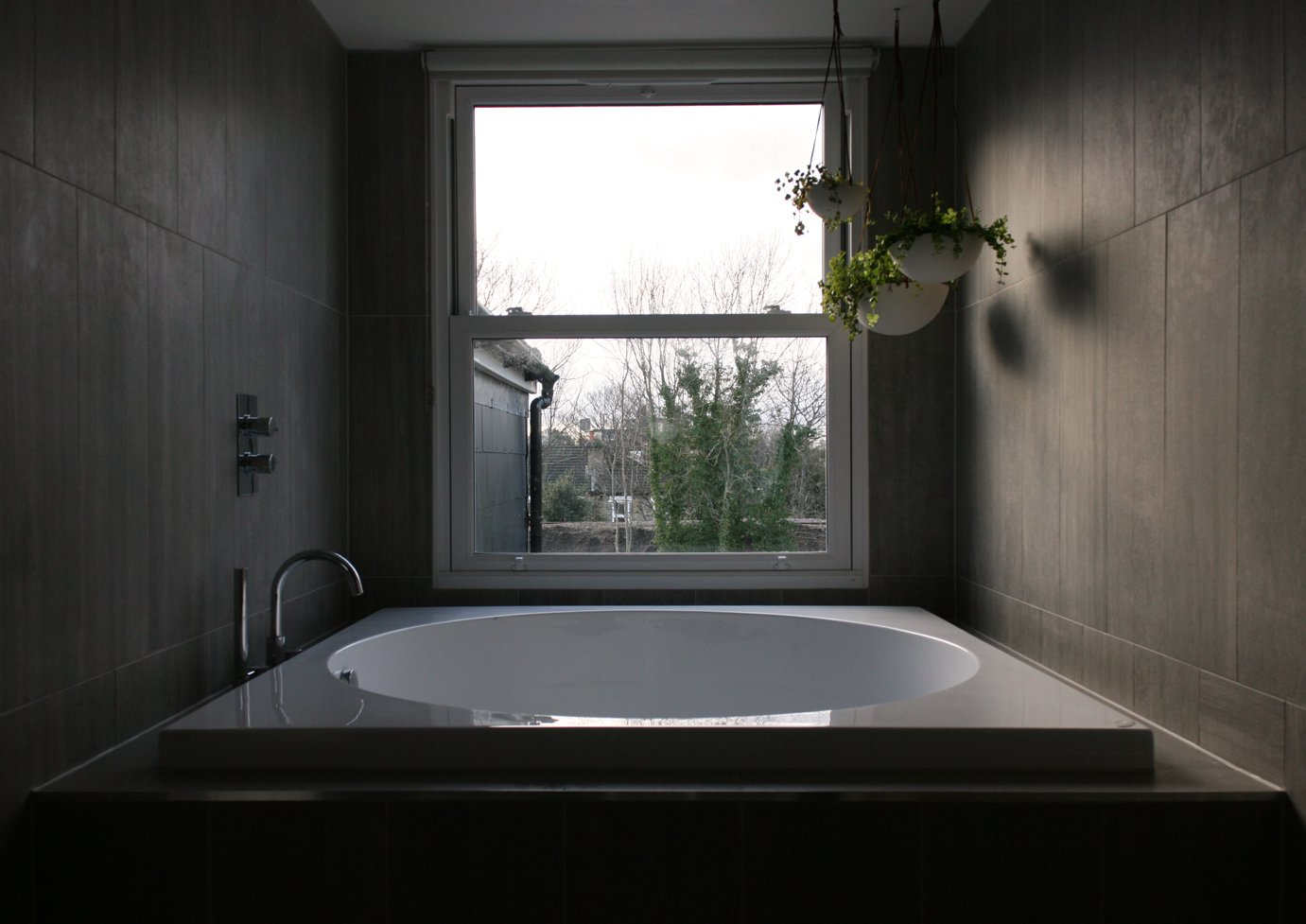 Bath Room, Alcove Tub, Ceramic Tile Wall, Engineered Quartz Counter, and Ceramic Tile Floor En-suite bathroom with feature bath tub  The Yellow Door by Tactus Design Workshop