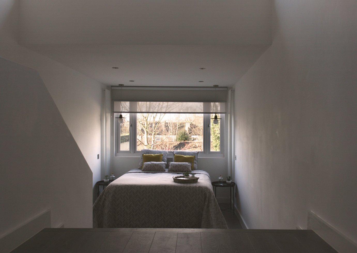 Bedroom, Light Hardwood Floor, and Bed Master bedroom  The Yellow Door by Tactus Design Workshop