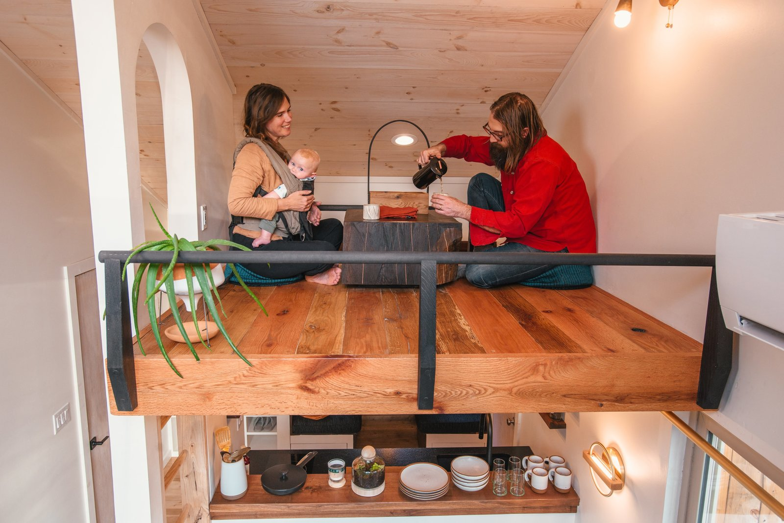 Shed & Studio and Living Space Room Type Architect Rob Maddox and Designer Karie Reinartson of Shelter Design Studio enjoy tea in the Tea Lost. The tea caddy features an extra long handle, so that when placed on a special shelf in the kitchen below it can be lifted easily into the loft.   Photo 7 of 11 in A Tiny Cabin in North Carolina Is an Enchanting Mix of Japanese and Scandinavian Style