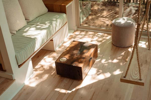 The black walnut coffee table slides into under the couch for additional floor space.