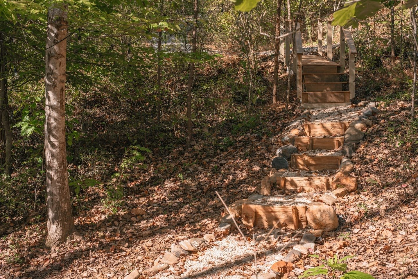Outdoor, Walkways, and Hardscapes Belleme built the steps on the path using the primitive building skills he had learned at Wild Roots, hand-splitting logs with a mallet and froe. To meet code, the house itself relies on more modern building methods.  Photo 3 of 11 in A Tiny Cabin in North Carolina Is an Enchanting Mix of Japanese and Scandinavian Style