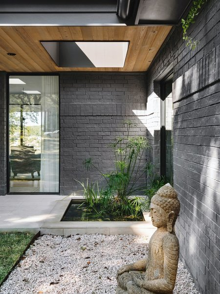 Transparent walls and Japanese design cues define this renovated home in an Austin suburb.