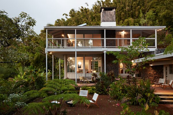 The home boasts numerous outdoor spaces, many protected from unpredictable rain showers.