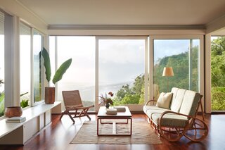 The built-in cabinet bench is original to the home, while Ginger's low, clean-lined furnishings underscore, without distracting from, the incredible views.