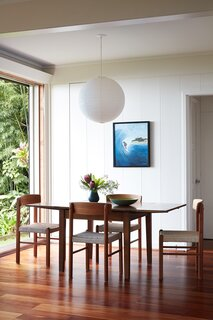 A painting by Ginger's grandmother hangs above a midcentury dining set Ginger found on Craigslist.
