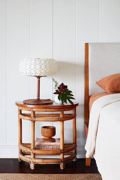 The nightstand is vintage, and the lamp is part of the 96 Molecules collection by Aqua Creations.