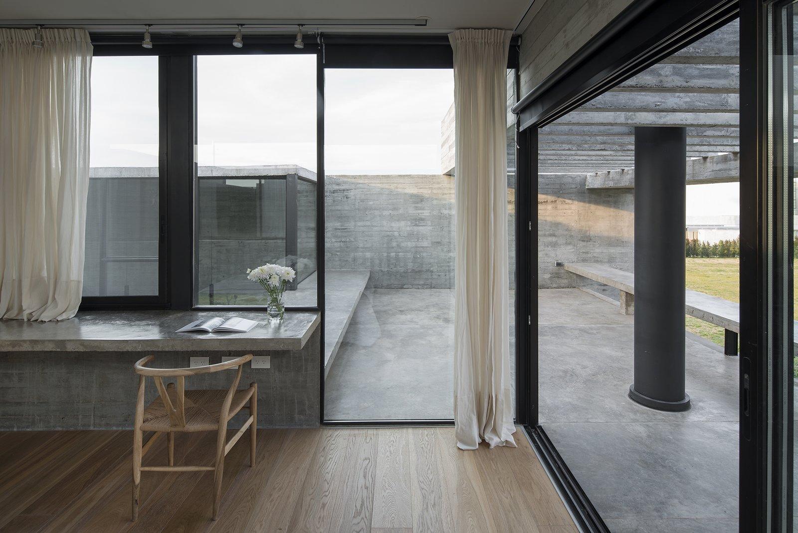 Bedroom, Medium Hardwood Floor, and Chair Castaños House by Arch. Ekaterina Kunzel & Arch. María Belén García Bottazzini  Castaños House