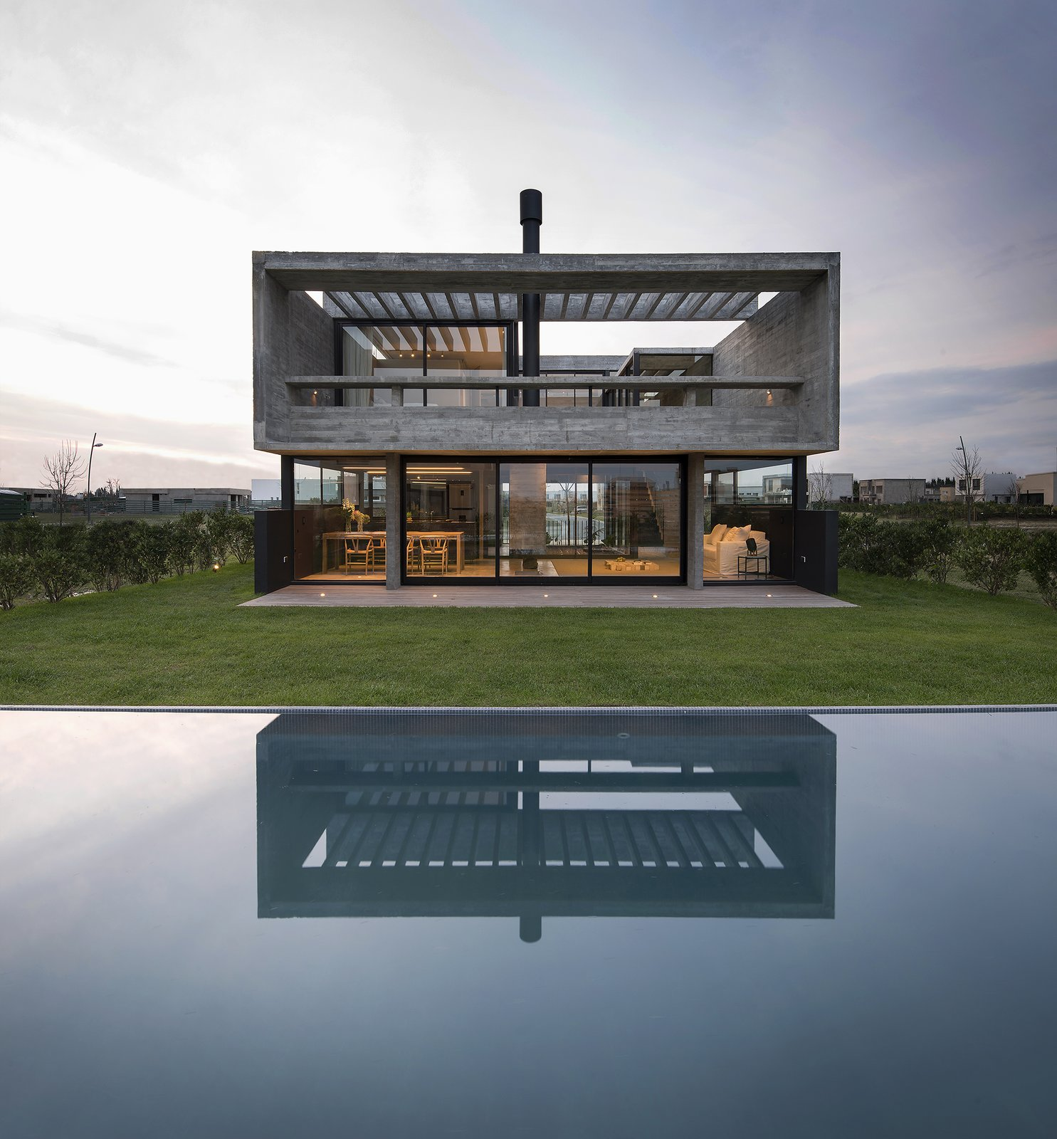 Outdoor, Infinity, Back Yard, Grass, Large, Gardens, Garden, Swimming, Concrete, Small, Large, Wood, Metal, Hanging, Decking, Concrete, Metal, Post, Landscape, and Concrete Castaños House by Arch. Ekaterina Kunzel & Arch. María Belén García Bottazzini  Outdoor Metal Swimming Concrete Photos from Castaños House