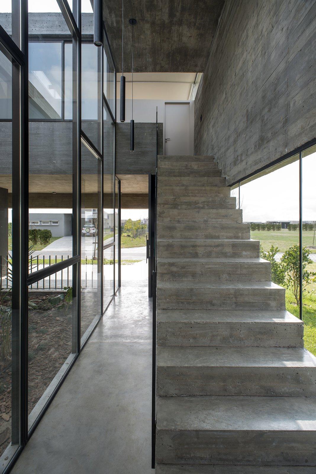 Staircase, Glass Railing, and Concrete Tread Castaños House by Arch. Ekaterina Kunzel & Arch. María Belén García Bottazzini  Castaños House