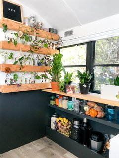 With a love of plants, Tina made greenery a focal point. She created wall to display her plant clippings. The thoughtful use of space allows her to keep plants without overwhelming the space. It's also a work of art.