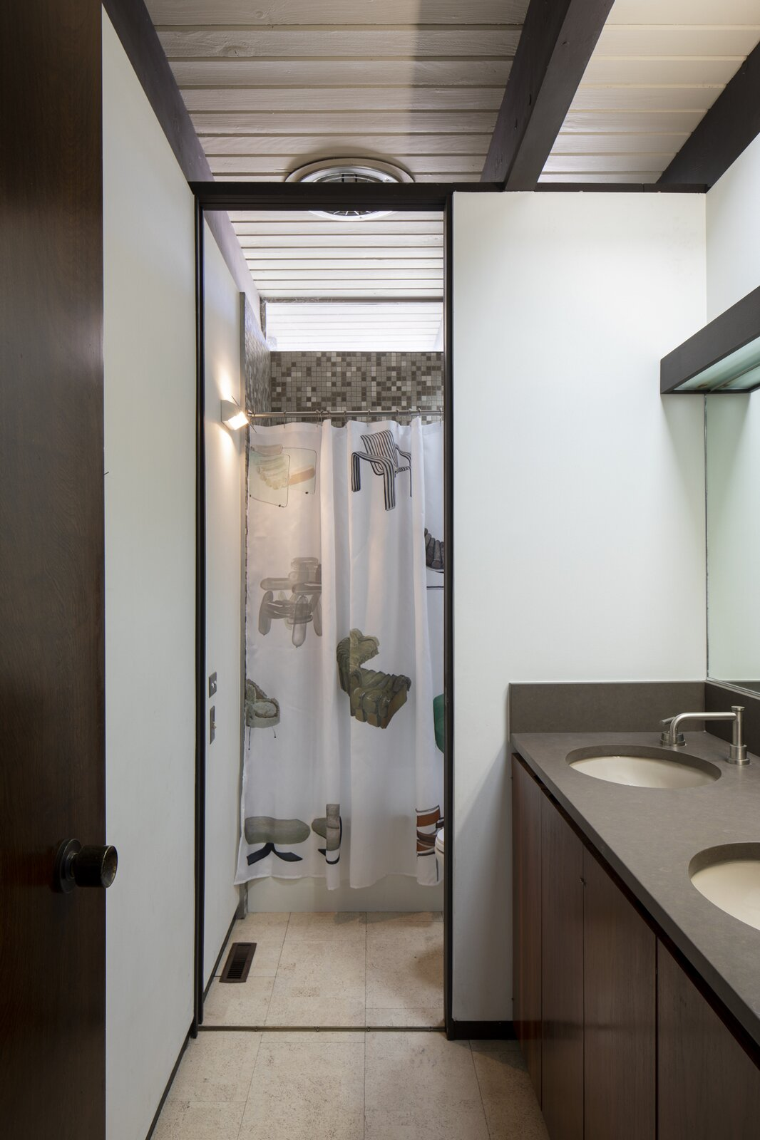 Bath, Light Hardwood, Laminate, Corner, Ceramic Tile, Ceiling, and Undermount The Shower Curtain features chair paintings by mixed media artist Miki Dessine.  Bath Corner Ceramic Tile Photos from Designer Sean Brown's Toronto Apartment Elevates the Y2K Aesthetic