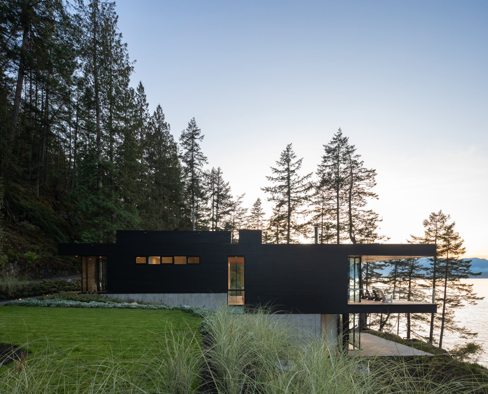 Bowen Island House exterior at dusk, by office of mcfarlane biggar architects + designers
