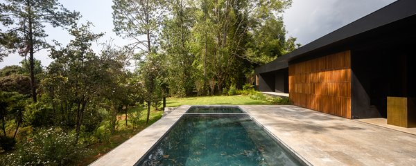 Family of the couple live in a dwelling nearby, but a combination of siting and landscaping means both can enjoy the privacy afforded by the remote property.