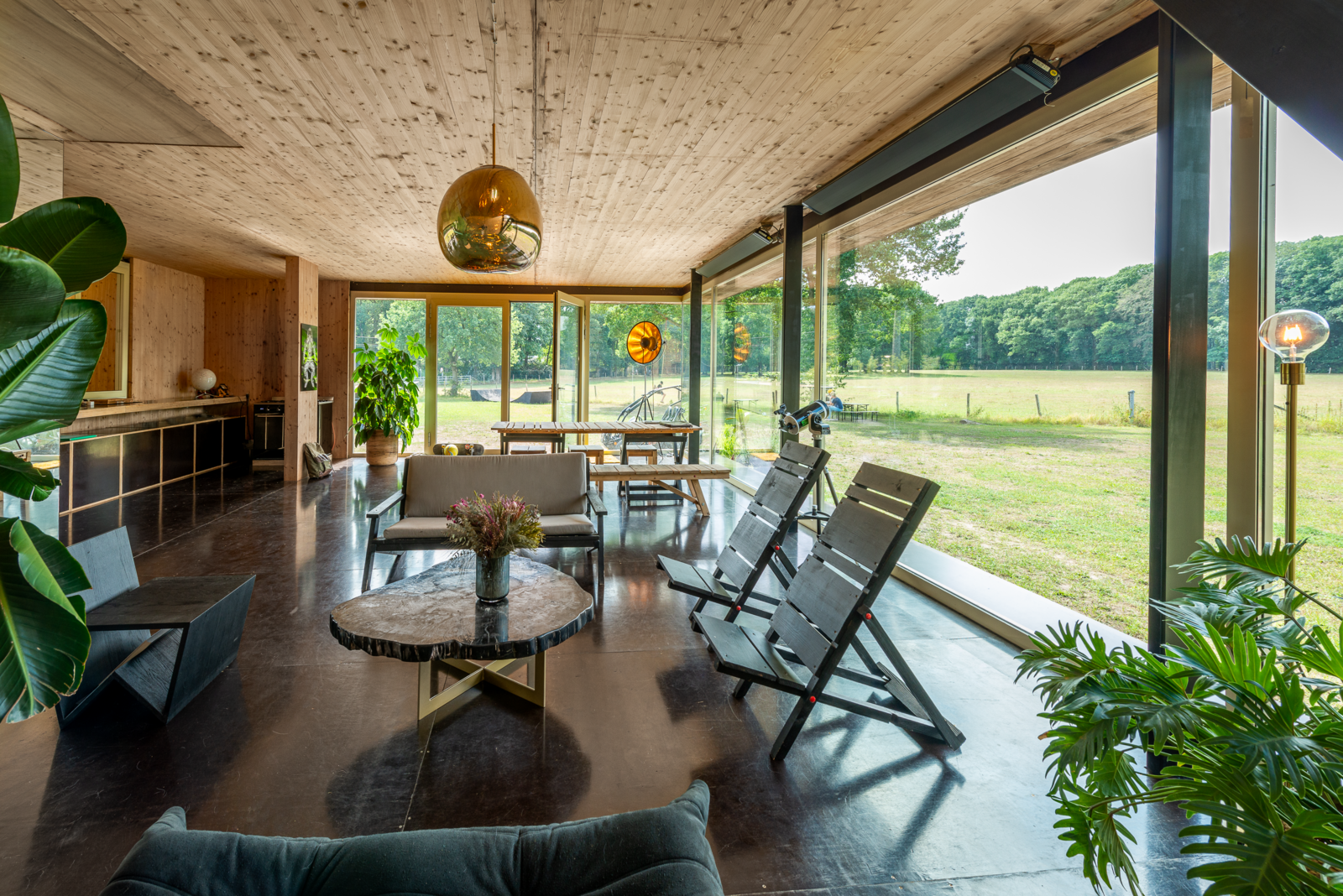 The Chairhouse (Villa Tellier) by ABN Architecten living area with floor-to-ceiling windows
