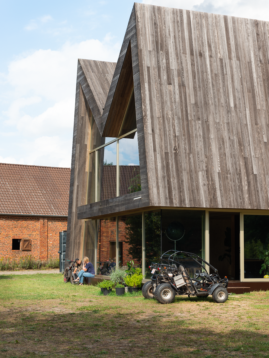 The Chairhouse (Villa Tellier) by ABN Architecten exterior with zigzag roof and off-road buggy parked