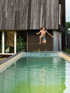 An 18-meter-long swimming pool invites the kids in for a dip.