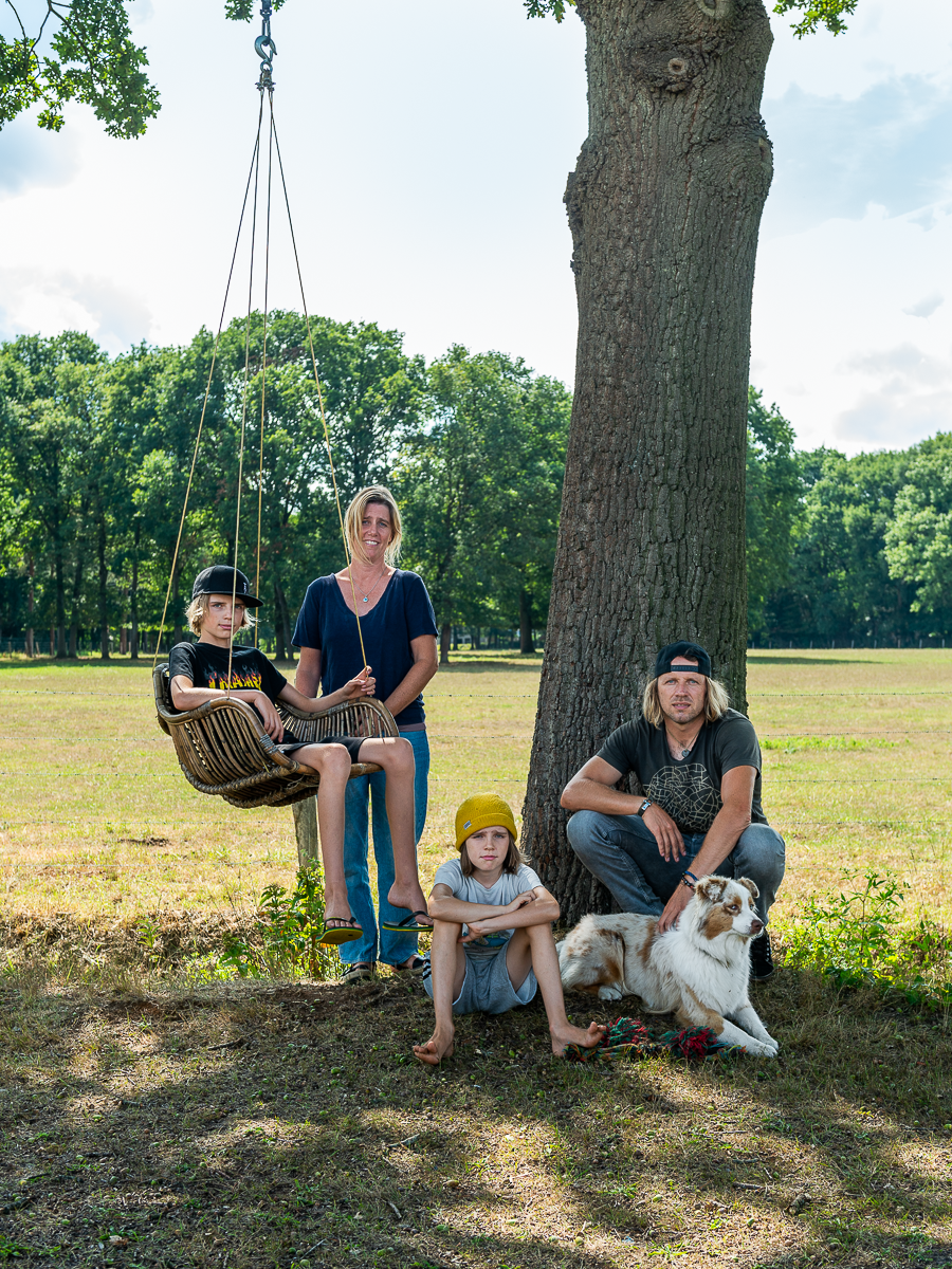 Homeowners Wim and Muriel pose in the backyard with their sons, Rio and Yenno, and their pup, Lola.  Photo 2 of 11 in A Belgian Photographer's Country Home Is a Playground for Kids and Adults Alike