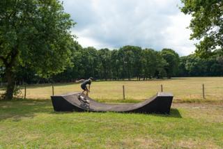 Plenty of opportunities for action await—including this custom skate ramp.