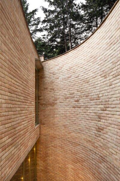 The exterior wall's gentle curve conveys a sense of enclosure.
