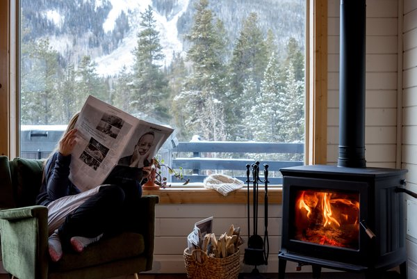 The DIY team replaced a noisy, burgundy pellet stove with a Vermont-made Hearthstone wood-burning stove, they created a cozy corner to guests to defrost from the Colorado cold.