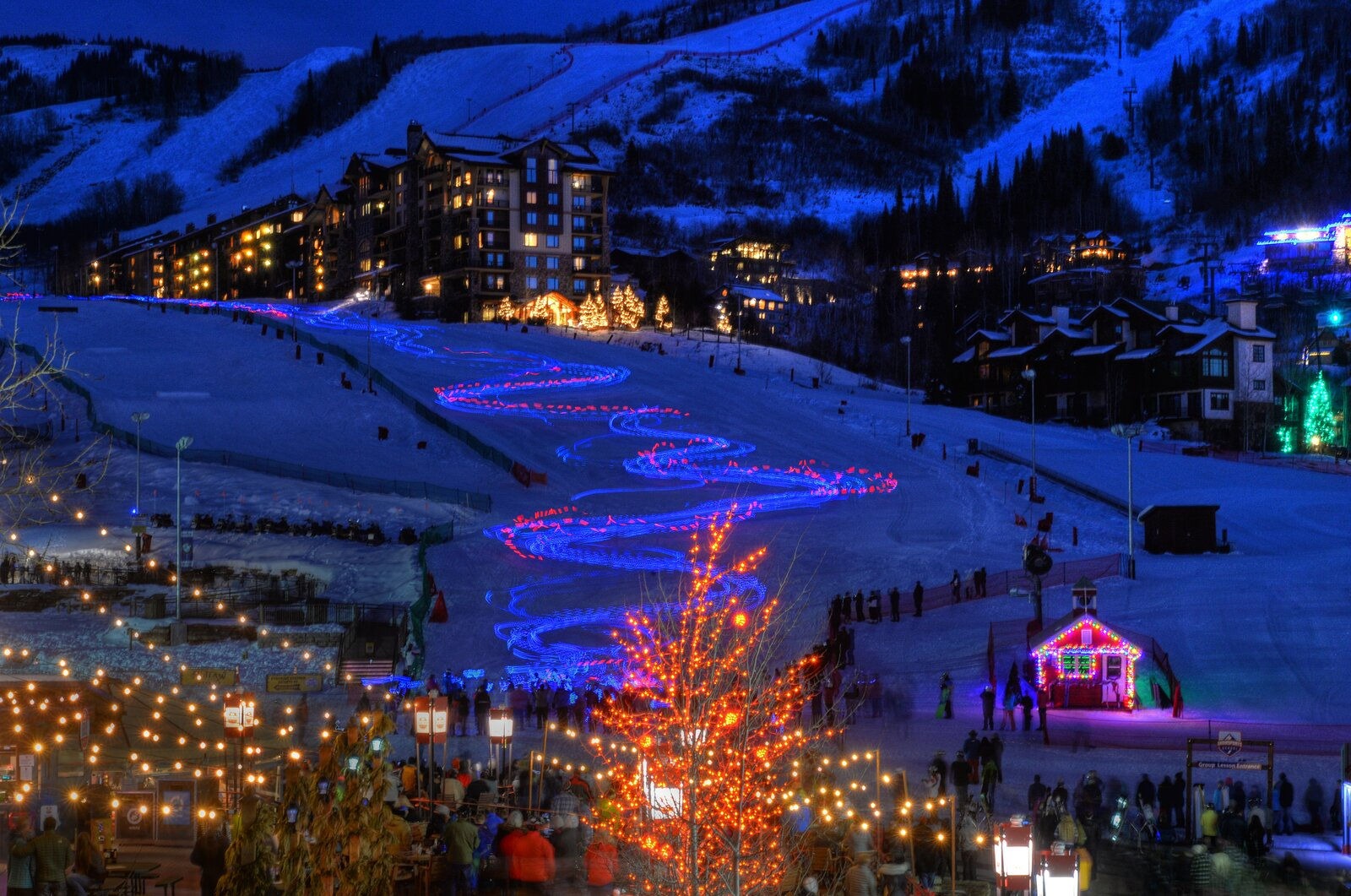 Festive lights mark the Torchlight Parade at Steamboat Resort in Colorado during the holiday season.