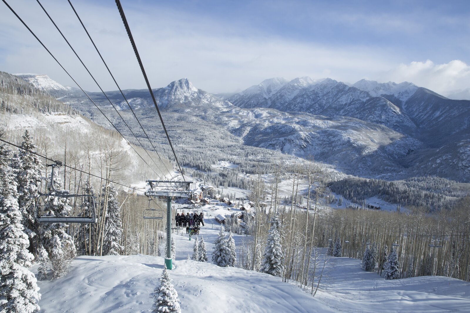 Snow covered mountains and lanscape are visible from the chair lift at Purgatory Resort in Colorado.