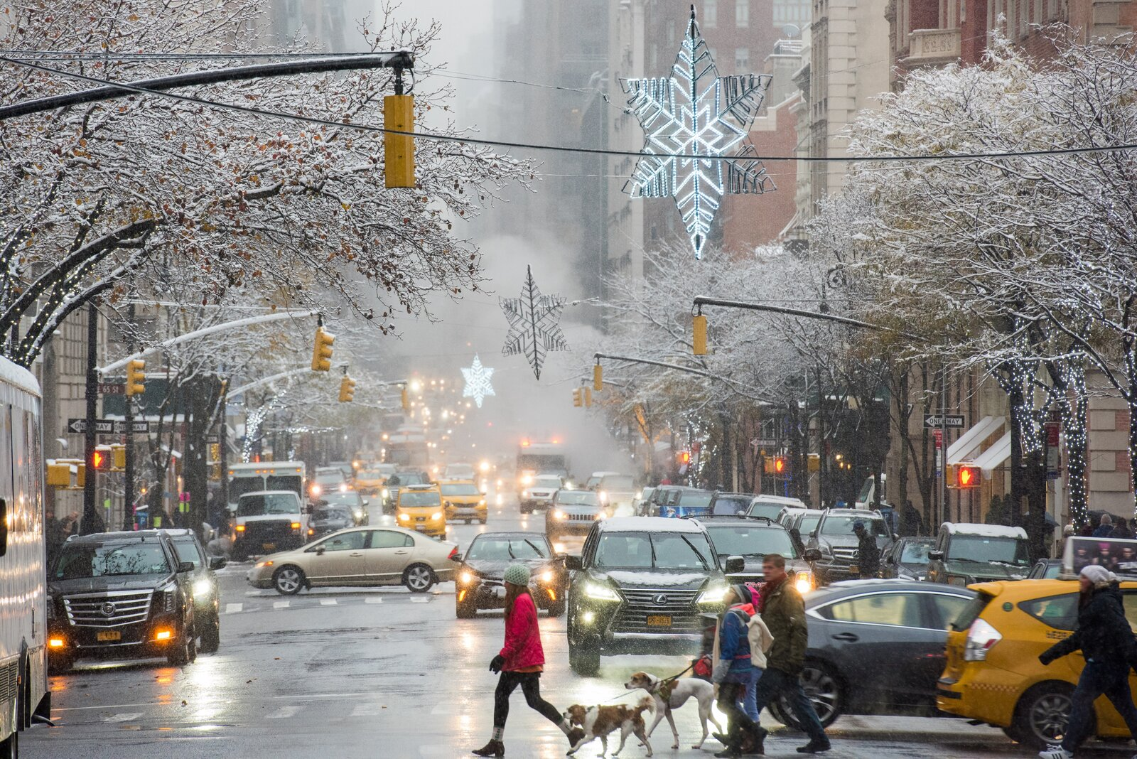 Snowflakes and holiday lights decorate a busy New York City during the holidays.