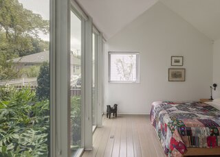 A casement window in the main bedroom allows for natural ventilation in this part of the home.