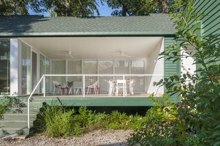 The dogtrot porch was designed with the Houston climate in mind—it's over four feet off the ground to help with the mosquitos, and it has a lattice screen to minimize the afternoon heat, and ceiling fans to create a breeze.