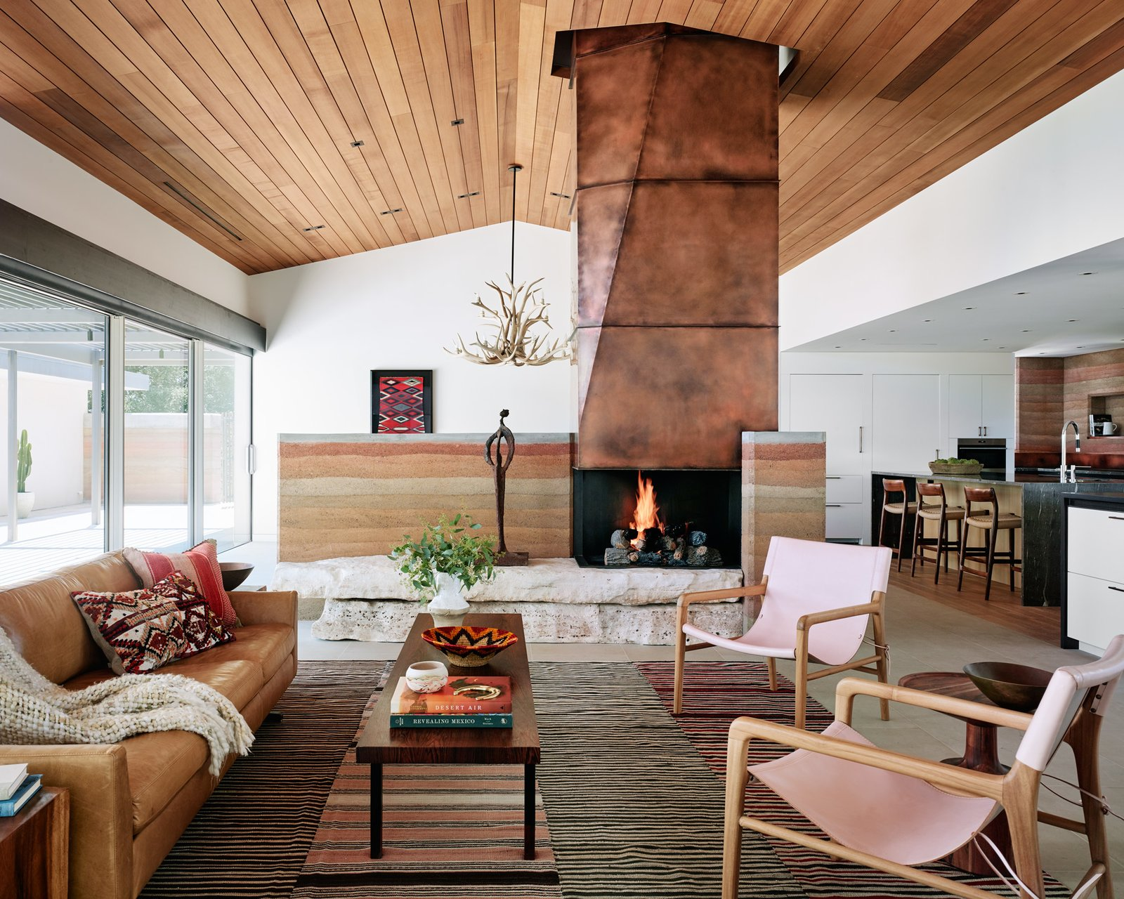 Jobe Corral Architects River Ranch house living room with fireplace.