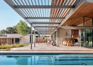 On the north side, you'll find the lap pool which runs 10 feet deep to accommodate one of the homeowners, who insists on entering the pool with a dive every time.