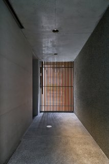 """From the city to the house, there's a big gap. You need to have a space to adjust to the feeling,"" says Ashizawa. The long form of the entry corridor does just that, taking cues from Japanese temple architecture to create a moment of intimacy before the awe. ""The house is lucky enough to have kind of a magical space."""