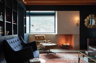 Firebrick lines both the wall and floor so that the fire can be lit right on the ground for an ultra-cozy night in.