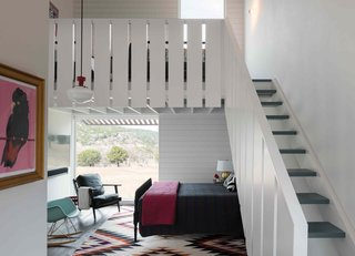 The railings in the casitas echo the details of the main house. The stair treads are painted the same dusty blue as the loft floor. These tiny bunkhouses are designed to sleep a family of four, and also house a little kitchenette and bathroom.
